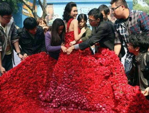 9,999 red roses sewn into a dress