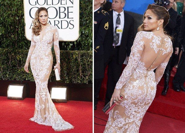 Jennifer Lopez, in a body-baring, long-sleeved cream lace Zuhair Murad gown